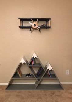 Adorable wooden bookcase and shelf that look like an airplane flying over mounta. Adorable wooden bookcase and shelf that look like an airplane flying over mounta. Wooden Wall Decor, Wooden Walls, Wall Art Decor, Baby Boy Rooms, Baby Boy Nurseries, Deco Cool, Wooden Bookcase, Baby Room Decor, Nursery Room