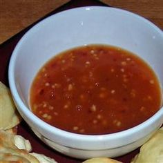 Sweet Chili Thai Sauce Recipe Condiments and Sauces with water, rice vinegar, sugar, fresh ginger root, garlic, hot pepper, ketchup, corn starch