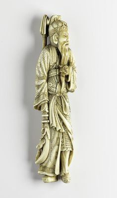 Netsuke of carved ivory, the general Guan Yu with a halberd, unsigned: Japan