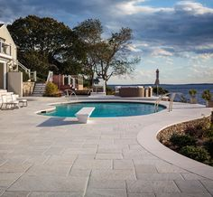 When designing a pool, the options seem endless. Pool decking can be done with tons of materials — slab, tile, brick, wood — so why choose pavers?