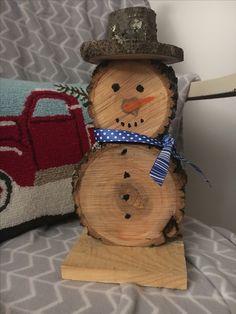 A little wood log snowman we made. Isn't he adorable!