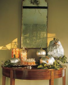 The shine in the silver pumpkins adds a splash of glamour to the dark holiday.