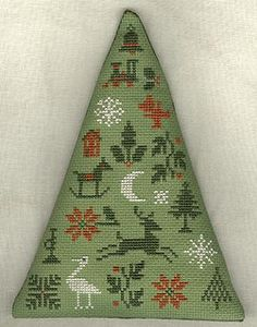 """From """"Christmas Trees"""" (The Prairie Schooler) by gio162, via Flickr.  Love the triangular shape."""