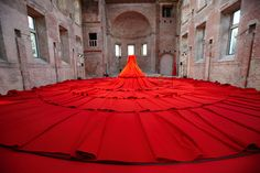 REDDRESS is an installation and performance space in the form of a colossal, red dress.