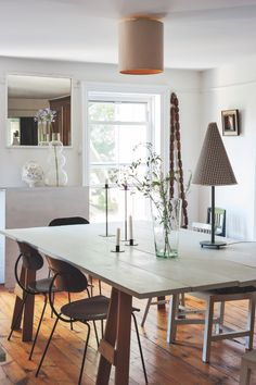 As we head into fall, layer your lighting—with standing lamps, table lamps, sconces, and candles—like Paris-born interior designer Corinne Gilbert did in her Brooklyn dining room. Decor, Modern Dining, Dining Room Lighting, Dining, Minimalist Dining Room, Home Decor, Table Lamps Living Room, Lamps Living Room, Interior Design