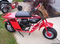 Tote Goat Motorcycle or Mini-Bike? These things are geared low and can pull heavy objects and climb trees! This is actually a Beautiful Restoration of a very ugly machine.