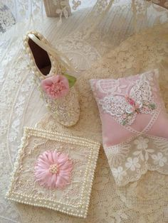 Shoe ornament, satin wallet, and sachet embellished with lace and silk ribbonwork by Kathleen