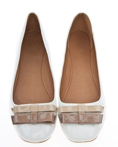 b3be0c98bdc9 Ballet shoes in a patent material and cute bows.