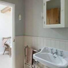 Shows towel rail on wall and sink Grey above white panelling. Simple white bathroom with tongue and groove panels Cottage Bathroom, Bathroom Styling, Dining Room Design, Small Bathroom, Tongue And Groove Panelling, Home, Bathroom Design, Bathroom Paneling, White Bathroom