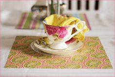 Great vintage tea party ideas.  I especially like the vintage hankies in the tea cups.