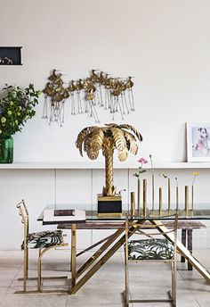 Loving all the brass, especially those stunning chairs - Fiona Leahy dining room from living etc via coco kelley