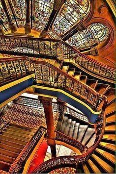 This stair case creates a rhythm throughout the room because the stairs do not create a pattern but they have similar likes in each of the stair cases that connect to each other.