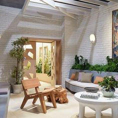John Dickinson Salao lounge chair and door. Preview the 2015 Architectural Digest Oscar Greenroom : Architectural Digest
