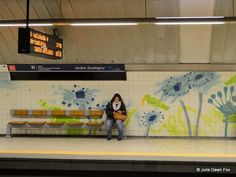 Lisbon's metro stations are an underground art gallery - by Julie Dawn Fox in Portugal 10.10.2013 | Lisbon's metro system is more than a convenient way of getting around the city - its stations form an underground art gallery with imaginative painted azulejos (tiles) and sculptures | Photo: woman waits at Jardim Zoológico metro station with painted tiles by Júlio Resende