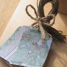 Map Gift Tag or Bookmark: Shape gift tags and bookmarks out of old maps and laminate them for a longer shelf life. Consider punching a hole on top and tying a string — perhaps a piece of rope — to dress it up.  Source: Etsy User Artesenias