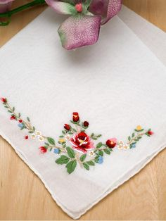 """Set of 3 Red Rose Wedding Handkerchiefs Embroidered with a lovely red rose design, this set of 3 handkerchief set is both colorful and vibrant.   Each handkerchief is made from 100% cotton and measures approx. 12"""" x 12"""" square"""