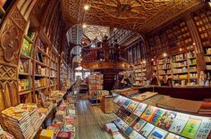 Livraria Lello, Porto, Portugal Imagine the biggest, oldest and most magnificent bookshop on the planet.  That's what you get when you visit Livraria Lello.  It's a very Harry Potter feeling place and sometimes you'll find hordes of tourists snapping selfies, but you must go and experience the magic of this one-of-a-kind bookstore.
