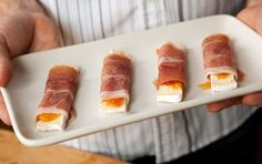 Make sure the prosciutto you use isn't too thinly sliced or it may fall apart when you assemble these tasty hors d'oeuvres. Substitute fig preserves, if you like.