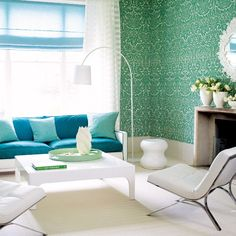 Vibrant damask wallpaper living room The cool azure green of this damask wallpaper creates a summery look in this living room. Farrow & Ball