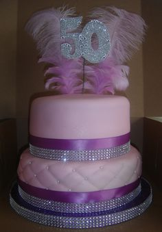 2 Tier 50th Bling Birthday Cake (top tier) Red Velvet and (bottom tier) Marble w/ buttercream and fondant.