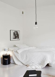 black and white minimal bedroom / white linen / white floor / simple hanging light.... love white interiors! x