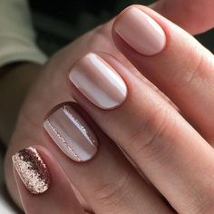 Light pink polish with glitter nails
