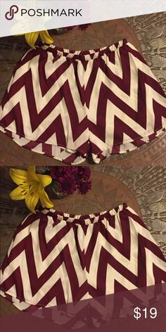 Chevron shorts! So dang cute! Elastic waist, fully lined and made in the USA. Perfect for any occasion. Garnet and white (not a bright white -- more of an eggshell/ivory) chevron. Shorts