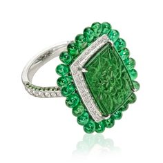 Carved Emerald Ring with Emerald and Diamond Accents | William Noble Rare Jewels