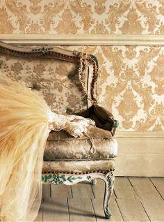 Damask wallpaper, settee, wedding dresd