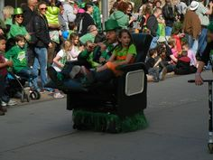 Saint Patrick's Day Parade in Salt Lake City, Utah 3/12/2016  Motorized armchair Leprechaun and his sidekick~