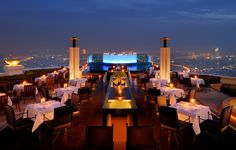 The rooftop Sirocco Restaurant & Sky Bar in Bangkok, Thailand is a place to drink & dine. Sirocco Restaurant & Sky Bar is a hip open-air restaurant and bar. Sky Bar Bangkok, Bangkok Hotel, Rooftop Bangkok, Bangkok Trip, Bangkok Restaurant, Hotel Thailand, Tokyo Trip, Bangkok Travel, Temples