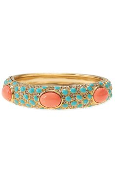 Turquoise enamel and coral cabochons on a gold plated bangle.      As seen in Redbook, and Ladies Home Journal!  stelladot.com/Tampa