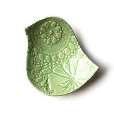 I really enjoy small pottery dishes that are uniques.  This one if so fun! Pottery Bowl Lacy Bird Key Lime Green Stoneware by PrinceDesignUK, $23.00