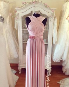 Eliza and Ethan multi way wrap bridesmaids evening dress in pastel pink. Available in lots of colours and over 20 ways to wrap.