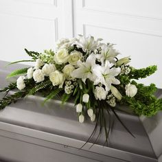 Order The Resurrection™ Casket Spray flower arrangements from All Flowered Up Too, your local Lubbock, TX florist. Send The Resurrection™ Casket Spray floral arrangement throughout Lubbock and surrounding areas. Arrangements Funéraires, Funeral Flower Arrangements, Funeral Flowers, Church Flowers, White Carnation, White Tulips, White Roses, Flower Spray, Flower Vases