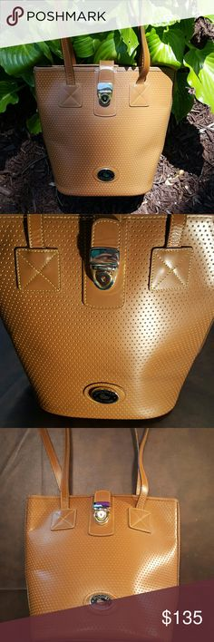 JUST INDooney & Bourke Perforated Bucket Tote Rare color, pretty Caramel brown d from Dooney & Bourke Cabrio Collection.     In near perfect condition. Very clean, no marks or stains or pen marks.  Perforated leather.  Sueded interior with one pocket. Gold Hardware looks great.  11in x 10in x 5in. 12in strap drop.  No marks on bottom.  Smoke free, pet free home. Dooney & Bourke Bags