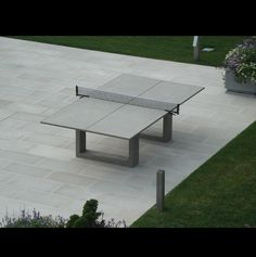 Outdoor concrete ping pong/dining table. Possibly the coolest thing ever.