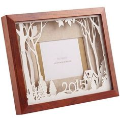 Turn a holiday photo into a lasting keepsake. Inside a frame of rustic brown pine, a laser-cut wintery forest scene is layered to create a unique, 3-D shadowbox effect. Dated 2015, it's the perfect frame for special holiday moments—ugly sweaters and all. Makes a great gift, too.
