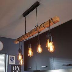 mélange du bois et du métal noir pour donner du style à votre intérieur #luminaire