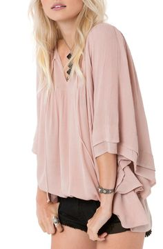 Woven crinkle gauze lends a dreamy ethereal feel to this lightweight split-neck top with abbreviated kimono sleeves.