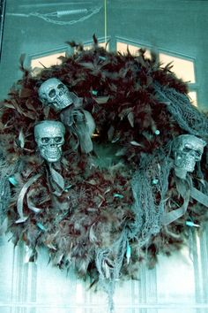 Skull Wreaths - Instead of using a wreath form, I could use the ¢.97 pipe insulation curved into a circle and go from there. I do have glittered skulls ready so I could do for one inside the house with skulls and one for outside the house with a spider theme.