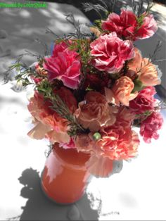 DIY vase and Carnations centerpiece for nautical bridal shower.