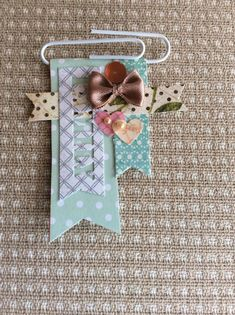 Embellishments #scrapbookideas I like FAMILY is punched out in the tab!