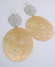 These earrings are gorgeous! I call them the Double Galaxy earrings. Exquisite silver and gold plated. Large statement earrings. To top it off