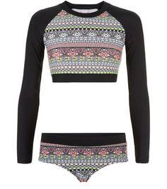- 1 long sleeve bikini top and 1 pair of bikini bottoms- All over aztec print- Stretch fabric- Long sleeve design