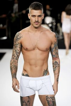 I am pinning him here this tiMe cos he has been on my easy on the eye board often enough. I love his revolver on the hip tattoo.