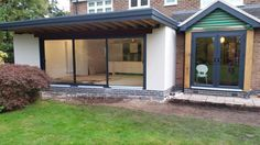 Smarts Aluminium triple track patio doors and Synseal Upvc French doors both in RAL7016 Anthracite grey. Installed in Edwalton, Nottingham. For a free quotation call us on 01158 660066 visit our website http://www.thenottinghamwindowcompany.co.uk or pop into our West Bridgford showroom.