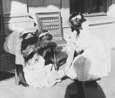 """Olga, Tatiana, and Maria. On 10 October 1900, Nicholas wrote to his mother that, """"The children have very much grown, and the little baby is walking well, but falls often because her elder sisters knock into her and generally push her around, if one does not watch them."""" Apparently that habit continued for several years, because this photograph was taken in 1903. Olga is on the left, Maria is in the middle, and Tatiana is on the right."""