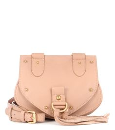 See By Chloé - Collins Small leather shoulder bag - See By Chloé's Collins Small shoulder bag is a compact style that's doused in bohemian appeal. The blush-hued leather is accented with gold-tone hardware and tonal tassels that will swing as you sling it over your shoulder. Wear yours with a pair of skinny jeans and oversized sunglasses in the city. seen @ www.mytheresa.com