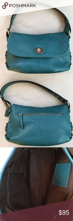 "🎁RARE Turquoise pebbled flap handbag🎁 RARE turquoise bag, pebbled leather, with flap over silver turn knob closure, back zipper pocket, 2 open compartments inside, inside zipper pocket, 2 open slot pockets adjustable strap approx 11"" approx 7"" x 4"" x 15"" , note some scratching on hardware, small scrape at bottom, overall condition of bag good. Look at additional pictures before purchasing. Coach Bags Shoulder Bags"